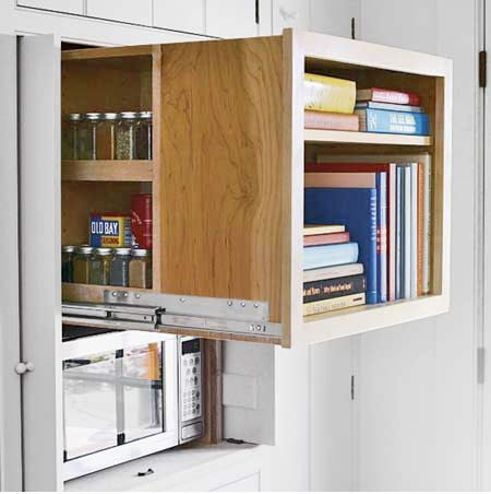 slide-out storage cube for extra deep cabinet conceals spices behind cookbooks