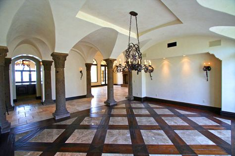 Wood And Travertine Flooring Wilth Cantera Columns And Vaulted