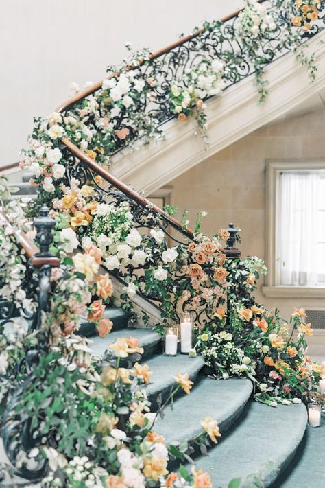 "From the editorial A Fantastical Floral Staircase Is Just The Start Of This Fairytale Day. @laurenfair says, ""@twistedwillowflowers adorned the lavish interior staircase with florals and greenery which served as the ceremony focal point. The jaw-dropping floral design on the staircase was a wow moment that will not soon be forgotten. 