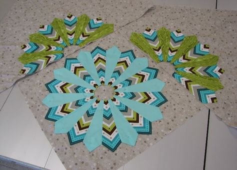 Gorgeous Dresden blocks by Patti, as featured on A Passion for Applique. I love the chevron/stripes matched with the solid petals.