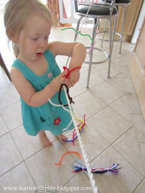 Pipe cleaners on a rope to develop fine motor skills. So simple, but wonderful, preschool to assess fine motor ability. Kindergarden to make alphabet letters