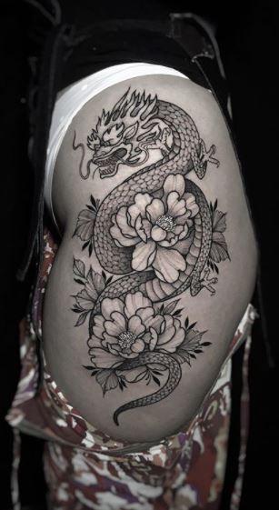 Dragon Tattoo With Flowers, Dragon Thigh Tattoo, Asian Dragon Tattoo, Hip Thigh Tattoos, Leg Tattoos Women, Flower Thigh Tattoos, Dragon Tattoo For Women, Spine Tattoos, Dragon Tattoo Designs
