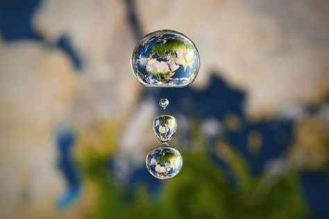"""""""A couple of weeks ago I stumbled across some truly stunning photographs by German photographer Markus Reugels, part of his """"Setup Liquid Art"""" series, depicting spherical representations of the Earth, Jupiter, and the moon, among other objects. The twist: they are """"liquid planets,"""" comprised of a drop of water caught mid-fall.    And there's no computer manipulation -- these shots are real."""""""