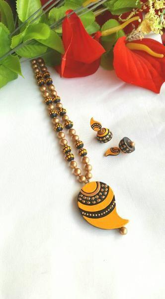 Golden and Yellow Mango Terracotta Jewellery Set | Terracotta jewellery  designs, Terracotta jewellery, Terracotta earrings