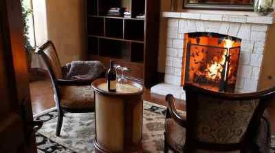 Cozy Chairs In Front Of Fireplace Chairs In Front Of Fireplace With Bottle Wine Stock Video Rhvideoblockscom Simple Small Living Room Jpg Cozy Chair Fireplace Small Living Room