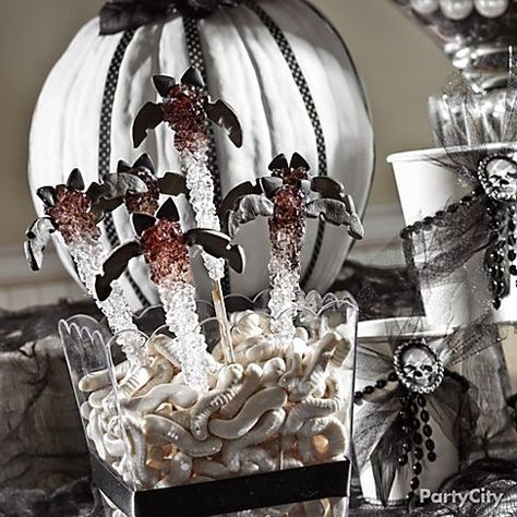 Get your DIY on with too-cute rock candy bats. They'll *fly* off your Halloween candy buffet!