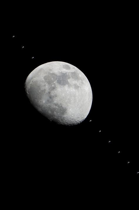 composite of the ISS orbiting in front of the moon