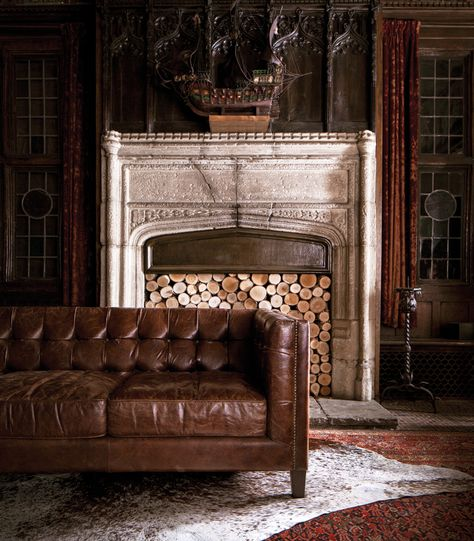 a nice match: leather sofa + cowhide rug. Jayson Home fall 2012 catalog.