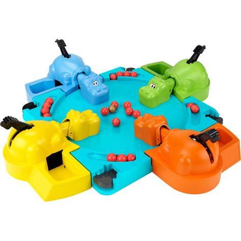 """Elefun & Friends Hungry Hungry Hippos Game. This game is great for speech activities. We played with our toddler to encourage connecting the concept of hungry with eating; we said """"blue hippo eat"""", and talked about the color of the hippos and the marbles. He played with the game for an hour without tiring of it. We're going to use this to motivate him to do non-preferred speech activities."""