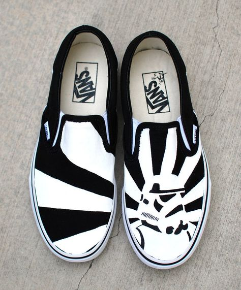 These one of a kind hand painted Vans Slip ons Feature a