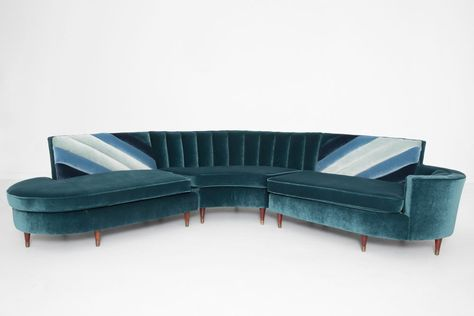 We recovered this 1960's channel tufted sofa in a lush peacock blue velvet and added some ombre effects.  This one is my new favorite!  #velvet  #vintage #midcenturysofa