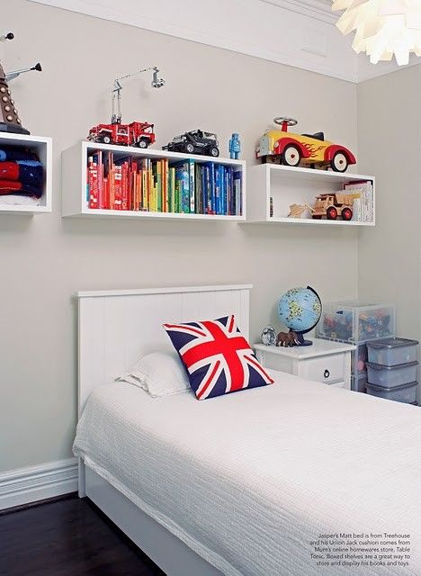 These shelving units are a great addition to this space and the accessories bring this boys bedroom to life.