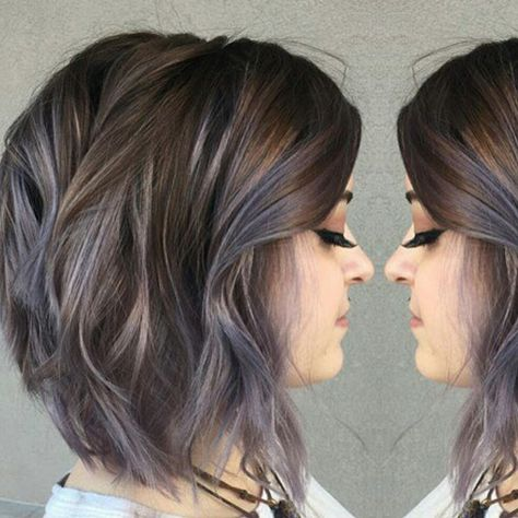 Subtle blue highlights in brunette hair. Color achieved by Aveda Color