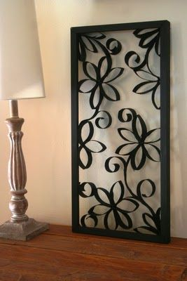 Wall Art made from toilet paper rolls, a picture frame and some black paint!