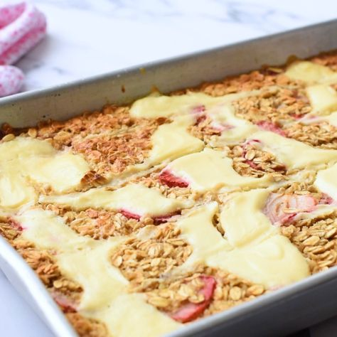 Strawberry Cheesecake Baked Oatmeal - Great breakfast to feed a crowd or make ahead for the busy week. #strawberrycheesecake #bakedoatmeal #bakedoats #strawberrybakedoatmeal #cheesecakebakedoatmeal #makeaheadbreakfast #easybreakfastrecipe #Christmasbreakfast #thewholesomedish