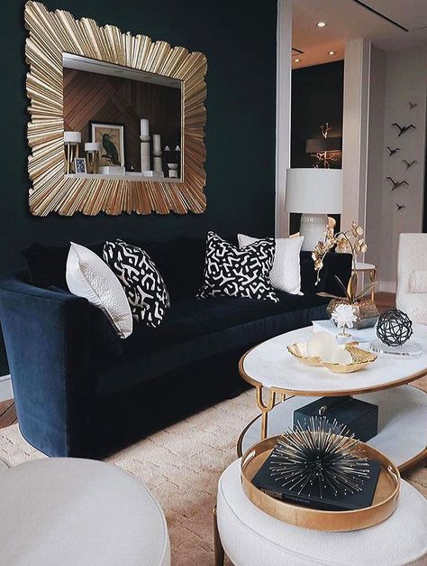 The perfect harmony of navy blue sofa and light color furniture. The golden glittering mirror behind the sofa and the harmony of other ornaments are really nice. If you are thinking of decor in navy blue tones, note this living room shape.