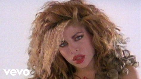 Taylor Dayne - Tell It To My Heart...My TWIN!!! ...When we were both younger. That's what everyone said anyways.  Except I was a lot thinner than her and I can not open my mouth THAT wide! No comments please.