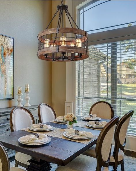 Look At That Metal And Wood Chandelier Basket Pendant It Adds An Industrial And Rustic Look Farmhouse Wood Dining Room Rustic Home Design Dining Table Decor