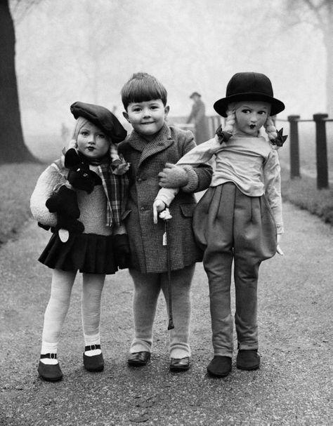 Vintage photo creepy dolls weird photo strange unusual boy holding big life sized  antique photograp