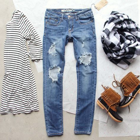 The perfectly distressed skinny jean for the season. Constructed from the…