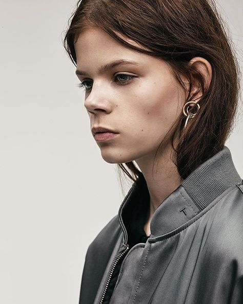 The #TBYALEXANDERWANG bomber with logo embroidery paired with rhodium and yellow gold triple hoop earrings for Resort 2017.