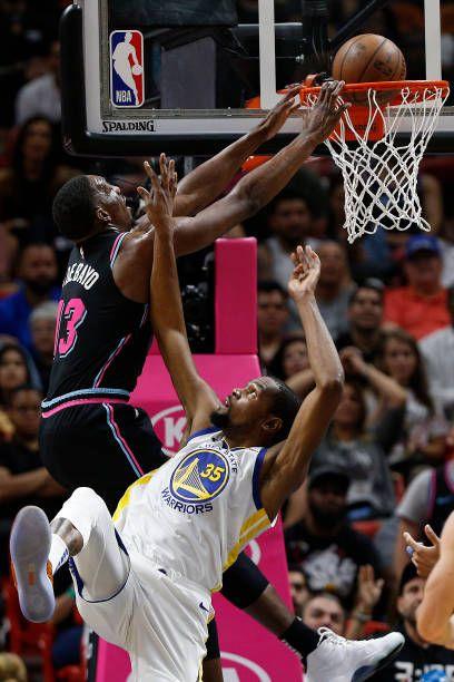Bam Adebayo Of The Miami Heat Dunks Over Kevin Durant Of The Golden Nba Miami Heat Miami Heat Basketball Miami Heat