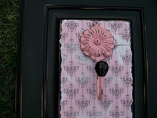 A bit of paint, craft paper, cute knob or hanger and voila!