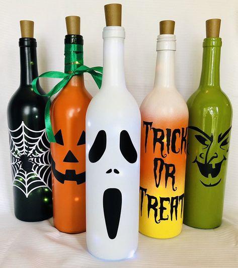 These lighted Halloween wine bott Fall Wine Bottles, Halloween Wine Bottles, Christmas Wine Bottles, Wine Bottle Art, Painted Wine Bottles, Lighted Wine Bottles, Diy Bottle, Bottle Lights, Empty Wine Bottles