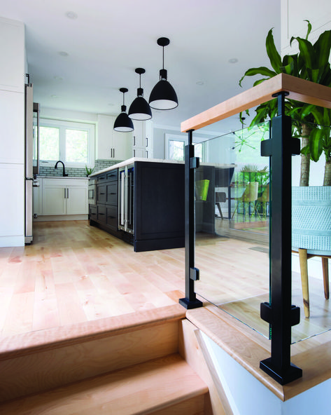 A split level living space, with industrial lighting and glass railing gin the kitchen. Split Level Entryway, Split Level Kitchen, Split Foyer Entry, Split Entry Remodel, Split Level Remodel, Home Renovation, Home Remodeling, Kitchen Renovations, Kitchen Remodel