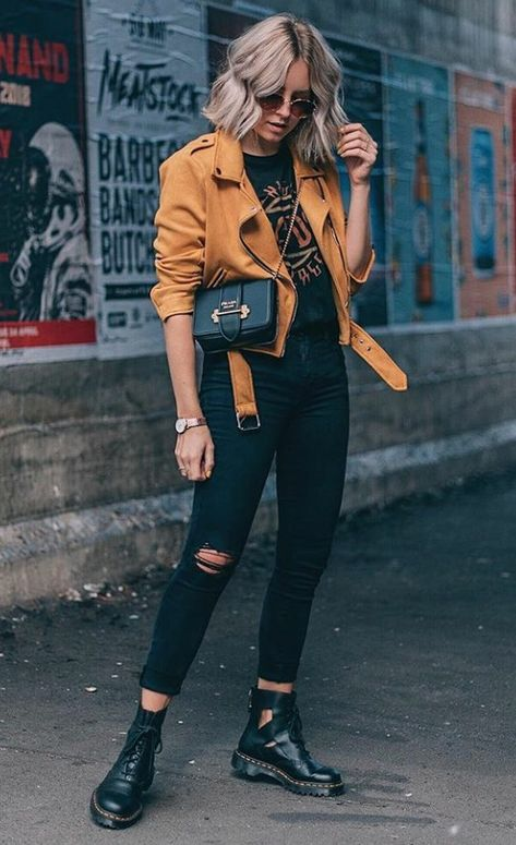 458348ba0dd Mustard yellow moto jacket with black ripped jeans and cutout black booties  and graphic t-
