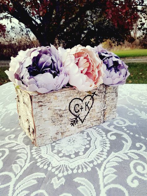 For a pastel spring wedding, a birch planter box carved and personalized with your initials makes the perfect simple centerpiece! Click through for more rustic wedding ideas. #rusticwedding #weddingcenterpieces #pastelwedding #springwedding #diywedding