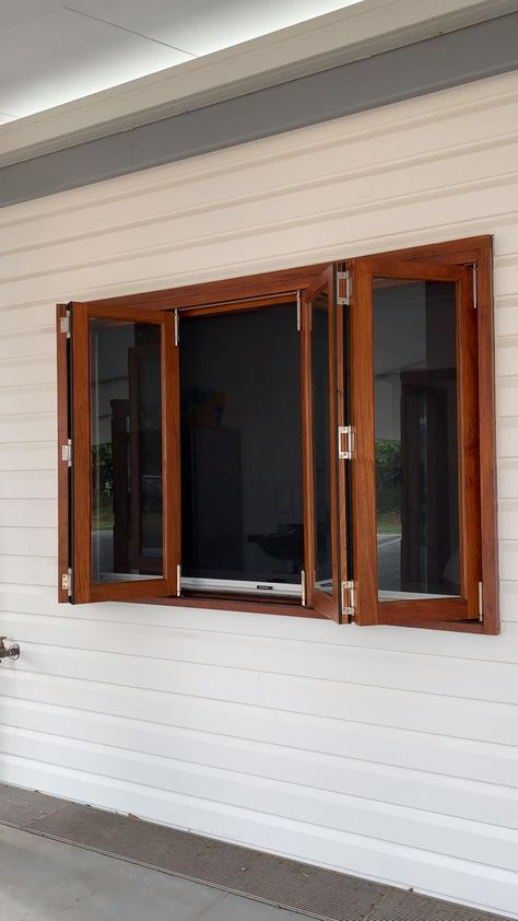 Timber Bifold window with screen