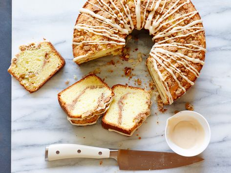 Recipe of the Day: Ina's Sour Cream Coffee Cake | Rich and tender, thanks to sour cream, Ina's sweet morning cake is finished with a nutty cinnamon-sugar topping and a drizzle of maple glaze.