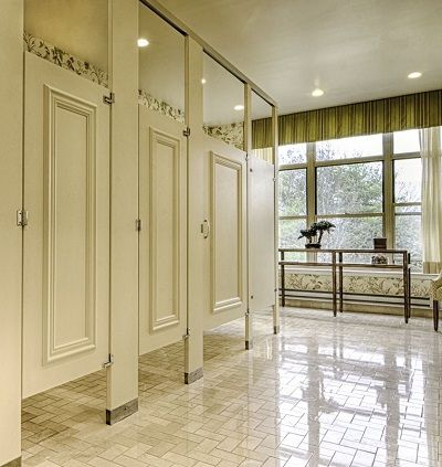 Bathroom Partitions Manufacturers ceiling braced partition with moldings on doors. ironwood