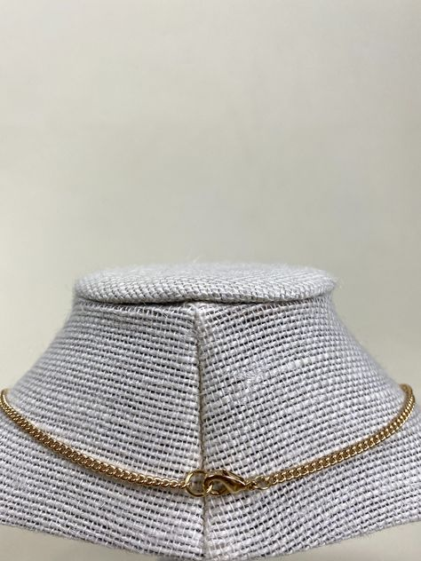 This dainty 16 inch chain necklace features 4 small blue tinted pendants. Iron gold colored chain - Nickle Free