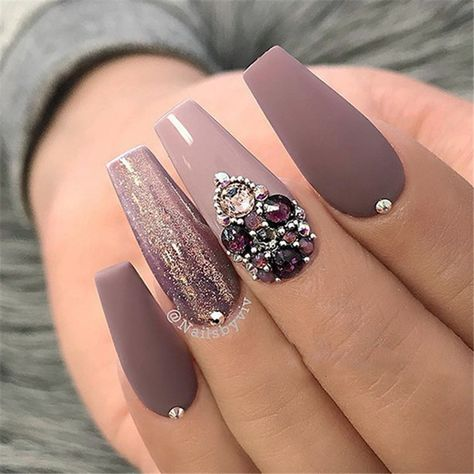 "If you're unfamiliar with nail trends and you hear the words ""coffin nails,"" what comes to mind? It's not nails with coffins drawn on them. Although, that would be a cute look for Halloween. It's long nails with a square tip, and the look has."