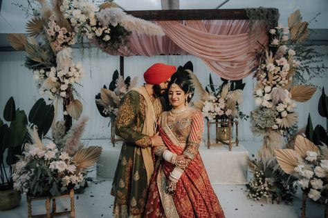 Sikh newlyewds share a sweet moment after their wedding ceremony. Photograph by Catch Motion Photography, VA #sikhwedding #sikhcouple #photography #photographyideas #backyardwedding #covidwedding #happycouple