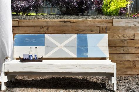 DIY Network shows you how to add cottage-style charm to a plain wood bench by painting it with seafaring flags.