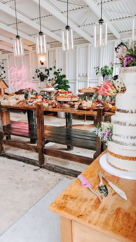 A beautiful rustic prop grazing table fit for a fairy tale wedding. #rusticwedding #rusticgrazingtable #grazingtable #grazingfood #cheeseplatter #cheeseboard #weddingcake #engagementfood #rusticvenue