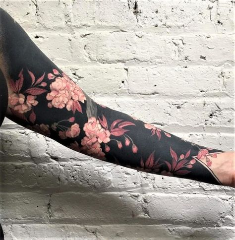 Flowers and blackout sleeve tattoo
