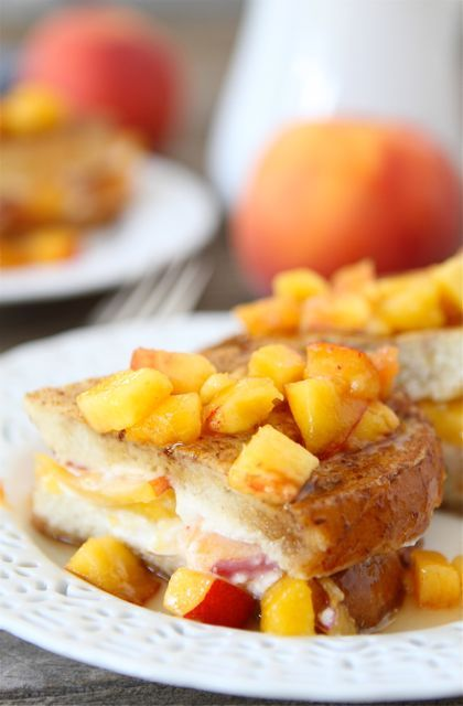 ---Peaches and Cream Stuffed French Toast--- :::For the filling:::  4 ounces cream cheese, softened  1 tablespoon powdered sugar  1/2 teaspoon ground cinnamon  1/2 teaspoon vanilla extract  1 cup sliced fresh peaches  :::For the French toast:::  4 slices French bread  4 large eggs  1/2 cup milk  1 teaspoon vanilla extract  1/2 teaspoon ground cinnamon  ---  Diced peaches and maple syrup, for serving
