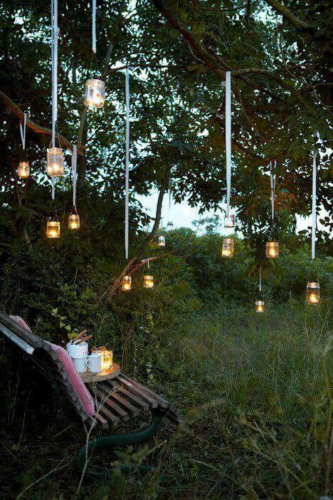 Mason Jars With Tea Lights Hanging From Trees Hanging Tree