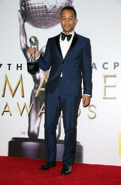 Musician John Legend poses in the press room with the President's Award during the 47th NAACP Image Awards presented by TV One at Pasadena Civic Auditorium on February 5, 2016 in Pasadena, California.