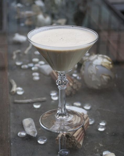 White Christmas  (1 ounce heavy cream  1/2 ounce Frangelico  1/4 ounce amaretto  3/4 ounce Patron Café  1 Ground nutmeg and cinnamon)