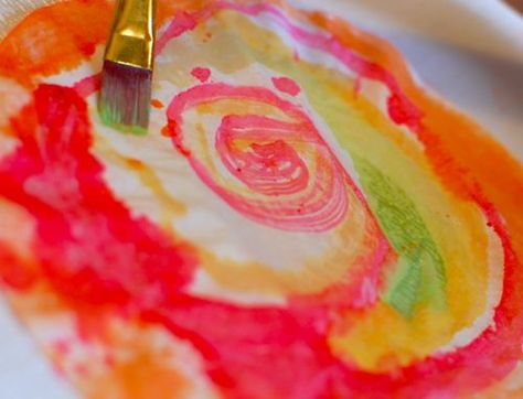 coffee filter flowers using watercolor have kids paint them then cut the shape of the flower you want
