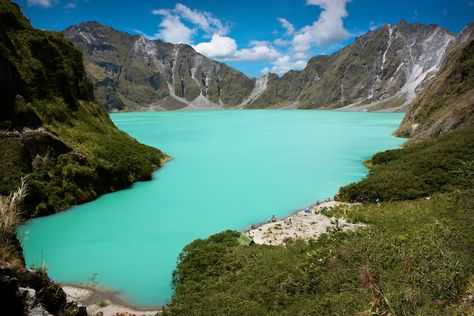Lake Pinatubo, Philippines, formed after the 1991 eruption of Mount Pinatubo has filled with water from monsoon rains. At 2600 ft, it is the deepest lake in the Philippines.
