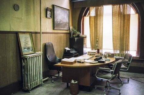 Irving Office 1: Set of Irving Rosenfeld's (played by Christian Bale) office.  Shot on location in Lynn, Massachusetts.  Furnished with distressed  but stylish couch and desk and geometric wallpaper as seen in Columbia Pictures' AMERICAN HUSTLE.  Production Design by Judy Becker Photo by:  Judy Becker
