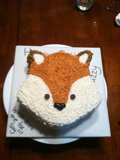 What does the fox say?  Round cake carved into a fox shape. Chocolate chips for eyes. Frosted with a star tip.