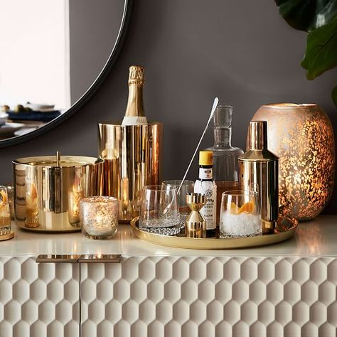 Your home bar will look as if a professional works behind it with this gorgeous bundle. KEY DETAILS Bundle includes: Brass Chelsea Tray, Brass Chelsea Ice Bucket and Metallic Base Decanter & Glassware Set. For full product details, please see: Brass Chelsea Tray, Brass Chelsea Ice Bucket, Metallic Base Decanter & Glassware Set. Home Bar Decor, Bar Cart Decor, West Elm, Bar Tray, Irish Decor, Home Bar Designs, English Decor, Vintage Bathrooms, Deco Table