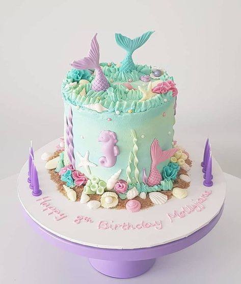 A tall, 4 layer cake with mud cake layers, chocolate ganache between layers, and a buttercream finish. Decorated with fondant mermaid tails, seashells, seaweed, coral, sugar sand, pearls, etc, to create the perfect Mermaid themed cake! You can customise with pastel or bright coloured decorations